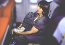 How to workout while travelling by plane?, in flight exercises, airplane exercise, airplane core exercise, airplane ab workout, exercise before long flight, feet exercises on planes, what exercises can i do on a plane, how to work out on a plane,